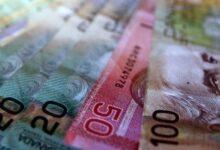 Photo of Le dollar canadien sous pression