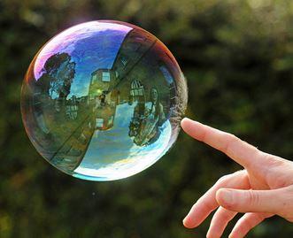 Photo of Que signifient les taux bas pour une bulle immobilière potentielle?